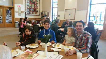 Photo of family having breakfast at chucrh